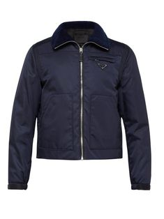 8d3af08f67e PRADA PRADA - DETACHABLE SLEEVE ZIP THROUGH NYLON JACKET - MENS - NAVY.   prada  cloth