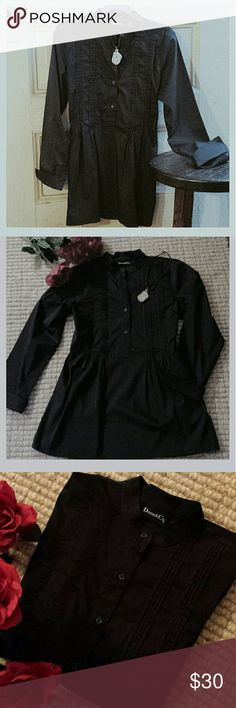 """Black Tunic dress Long cuff finish sleeves--pleated front detailing runs alongside 3/4 button front.  Small collar and roomy drop waist.  Cotton/Polyester/Spandex blend.  Length of tunic from shoulder to bottom hem: 31"""". Sleeves: 23-25"""".  Thrown skinny jeans and cute booties! NWOT Tops Tunics"""