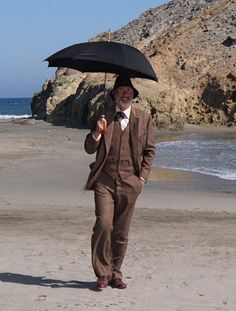Full Suit - Daylight with umbrella Sean Connery as Dr Henry Jones taken from Indiana Jones and the Last Crusade Copyright Paramount Pictures Herringbone Suit, Henry Jones, Sean Connery, Harrison Ford, Paramount Pictures, Indiana Jones, James Bond, Movie Tv, Indie