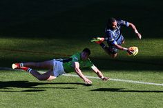 Gideon Gela-Mosby of the Cowboys scores a try against Nick Cotric of the Raiders during the 2017 Auckland Nines match between the Cowboys and the Raiders at Eden Park on February 4, 2017 in Auckland, New Zealand.