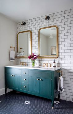 bathroom remodel with gold mirrors and faucets, schoolhouse lighting, dark vanity, subway tile Hammer and Hand