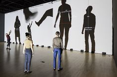 Interactive video and sound installation at SFMOMA...responsive, allowing visitors to tune in to radio frequencies.   Rafael Lozano-Hemmer  Frequency and Volume, Relational Architecture 9, 2003