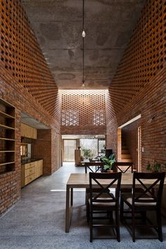 The Termitary House is the renovation of a two-storey home located in the coastal town of Da Nang, Vietnam
