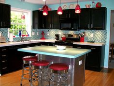 -Powder blue walls -black cabinets -Chrome and red fixtures/accents -Tile backsplash and under cabinet accent lights.