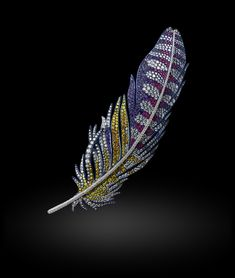 Michelle Ong. Precious Plume. White and Yellow Diaond, Ruby and Amethyst brooch set in Platinum and Titanium.