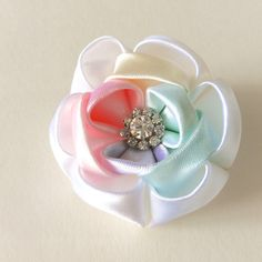 Excited to share the latest addition to my #etsy shop: Rainbow Flower clip. Kanzashi Ribbon flower hair clip. Rainbow Kanzashi flower barrette clip . Rainbow flower duckbill clip. #patch #rainbow #white #flowerhairpin #flowerbrooch #flowerhairclip #accessories