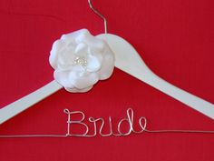 SALE Personalized Wedding Hanger with Rhinestone Flower Accent. Brides Hanger/ Bride/ Name Hanger/ Wedding Hanger / 47 ribbon colors. $19.99, via Etsy.