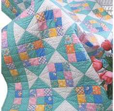 The Sweetie Pie quilt pattern is easy as pie and cute as a baby! With the Sweetie Pie Quilt Pattern, you can quickly strip-piece the blocks and set them together with an Hourglass block. This quilt pattern is a . 9 Patch Quilt, Quilt Blocks, Quilting Projects, Quilting Designs, Sewing Projects, Quilt Baby, Bed Quilt Patterns, Girls Quilts, Scrappy Quilts