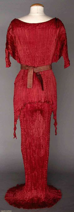Raspberry pleated silk gown, attached long over-tunic, small brick red & turquoise glass beads, short lily sleeves, matching stenciled belt