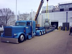 Slammed flat Peterbilt TriAxle with 2 axle RGN.