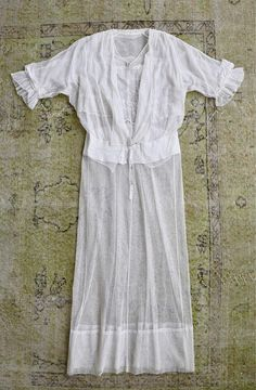 "Tulle chantilly lace Edwardian dress. Soft cotton embroidered eyelet embellishments at collar and sleeves. Hook and eye closure down front Bust: 34"" Waist: 26"" to 28"" Hip: 40"" Length: 48"" Shoulder to waist: 17"" *Flexible fit, there is stretch Very good condition. Some small snags,"