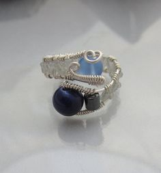 Sterling Silver Wire Wrapped Ring with Pale Blue Sea by studiodct, $27.00