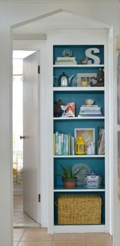 The best way to show off your book collection? Stack 'em in front of a bold blue wall. We especially love how the paint inside this organizer makes what used to be a skinny pantry look like a built-in bookcase.  See more at Plaster & Disaster »