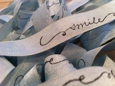 Printed ribbon  I've been dying to try this ! Just need to find the right stamp. Love the idea of wrapping them around bouquets.