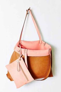 also in black and tan Reversible Vegan Leather Tote Bag - Urban Outfitters