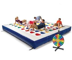 A giant, inflatable TWISTER game!  Oh my gosh I have got to play this in the middle of the lake!