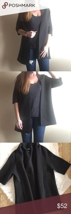 """Eileen Fisher charcoal grey ribbed open cardigan Gorgeous sweater by Eileen Fisher with an open front and thick, ribbed knit. Half sleeves. The fabric tag is faded so I'm not sure the material but I have hand washed/flat dry. Great pre owned condition! I a 5'7"""" for fit reference. Eileen Fisher Sweaters Cardigans"""