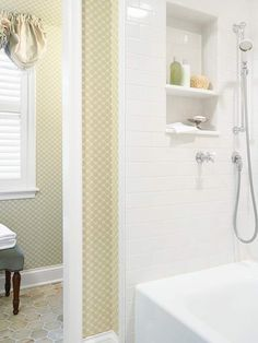 """""""Across from the vanity and sink, crackled subway tile lines a niche in the combination tub/shower. Shelving within the shower walls offers a convenient storage space for supplies."""""""