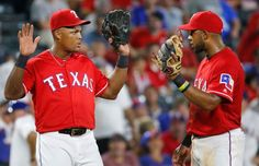 Texas Rangers third baseman Adrian Beltre (29) and shortstop Elvis Andrus (1) are pictured during the Los Angeles Angels vs. the Texas Rangers major league baseball game at Globe Life Park in Arlington on Monday, September 19, 2016. (Louis DeLuca/The Dallas Morning News)
