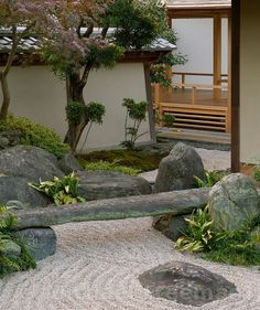 A modern Japanese Zen garden with a square meditation seat set in the centre at the Gion-ji Temple, Mito, Japan. Design by Japanese landscape gardener Shunmyo Masuno.