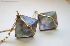 One necklace featuring a light purple and green fluorite octahedron crystal, electroformed in gold, dangling from a 28 shiny golden raw brass chain.  Pendants hang about 1.5 long, including the bail.  You will receive one from the photo.