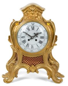 A Louis XV Style Gilt Bronze Bracket Clock Height 16 inches.