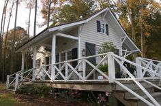 cute little house / traditional exterior by Gerald D. Cowart, AIA, LEED  AP FORD PLANTATION- COPP BOATHOUSE