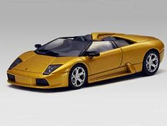 This Lamborghini Murcielago Roadster Diecast Model Car is Gold and features working wheels. It is made by AUTOart and is scale (approx. Lamborghini Models, Diecast Model Cars, Electric Motor, Motor Car, Scale Models, Wheels, Gold, Car, Automobile