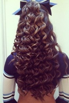 I would do anything for curls like this :( love cheer hair!!