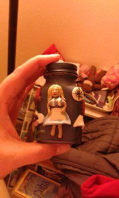 Alice in wonderland front half.  Sculpey clay on glass jar.