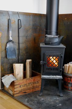 Looking for a small wood stove like this.Stove and hearth. Wood Stove Surround, Wood Stove Hearth, Stove Fireplace, Wood Burner, Fire Surround, Wood Stove Wall, Diy Wood Stove, Hanging Fireplace, Fireplace Tools