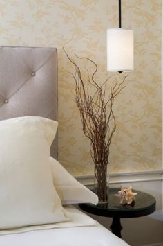 Placing curly willow branches in vases to incorporate nature in your home decor
