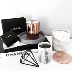 Love the marble and rose gold coasters and candle holders as well as the chanel decor