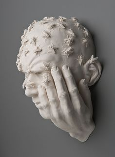 Man covered in bees porcelain sculpture by Kate MacDowell