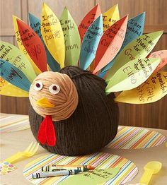 Ask each child to write what she's thankful for on a paper feather, then stick it into this cute turkey centerpiece.