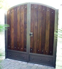 Iron & wood Double Arch Gate with Kickplate and Clavos - J&G Welding