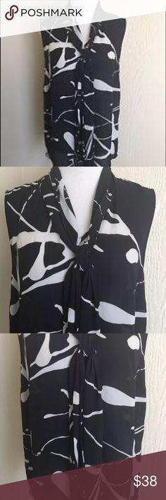 """Anthropologie Meadow Rue Black Tunic Black and white splattered print. Ties at the neck. Sleeveless. Long draped neck tie. Pleated in the back. 100% Polyester. Bust 40"""". Waist 42"""". Length 25"""" Anthropologie Tops Tunics"""