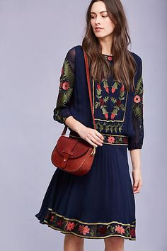 Ariella Embroidered Dress. Intricate floral embroidery graces this classically feminine silhouette. Our favourite way to wear it? With a leather satchel and ankle boots.