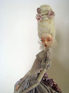 Rosemari.11    33 cm tall, wool hair, linen dress, wooden stand, oil and acrylic paint.