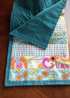 Small Doll Quilt from fabric strips and upcycled pillowcase.
