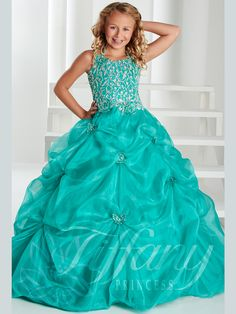 Your stunning girl will wow the entire crowd when wearing this Tiffany Princess pageant ball gown 13410, that features a halter scoop neckline as well as A.B rhinestones clustered all over the bodice and tiny straps. The Organza full skirt is enhanced with pick-up details and heat-set stones that create butterflies for a magical  vibe. Lace-up back to have the perfect adjusted figure. Features:  Silhouette: A-Line Ball Gown  Neckline: Halter Scoop  Fabric: Organza Sizes Available: 0 through…