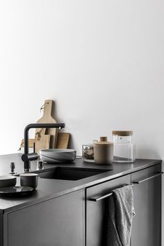 A beautiful all black kitchen and and dining room with lots of cork | Vosgesparis | Bloglovin'