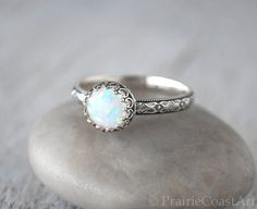 Beautiful flashes of color in this simulated Opal Ring in Sterling Silver, handforged band and set in a sterling crown setting.  ● 8mm simulated Opal ● 3mm Sterling Silver band  This ring will be handcrafted in my studio and Made To Order in your size. Please allow 3-5 business days for your ring to be made.  Gift box included.  You can also stack thin silver bands with this ring.  Ring Sizer: If you do not know your RING SIZE, you can purchase a ring sizer from my shop here…