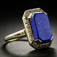 Art Deco Lapis Lazuli Ring. From depression-era America comes this colorful, and opposite of depressing, vintage ring featuring a bright blue beveled rectangular-cut lapis set in a geometrically engraved mounting with small green and red enamel highlights adorning the top of the ring shank.