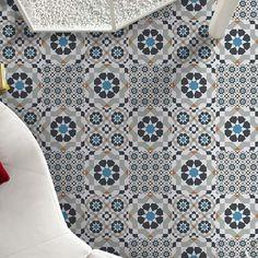 Geometric patterned floor tiles
