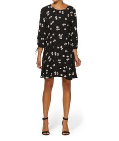 The Floral Tie Sleeve Dress equals effortless weekend style. This floral print dress features round neckline, 3/4 length sleeves with tie detail and keyhole & button back.