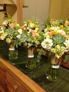 Bridesmaids bouquets. Garden Gate Florals-Orlando. Peach, yellow and sage weddings. #succulentbouquets