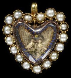 Gold set with half pearls surrounded by embroidery under faceted crystal. England, Great Britain ca. 1700