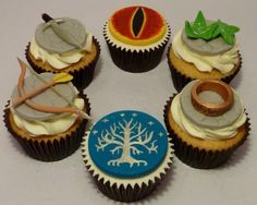 LOTR Cupcakes - the Eye of Sauron, the One Ring, the White Tree of Gondor, Legolas' Bow and Arrow, Lorien Leaves, and the Sword of Aragorn.