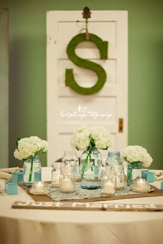 Love the idea of getting a large letter from the craft store of the bride's new last name and decorating or painting it.